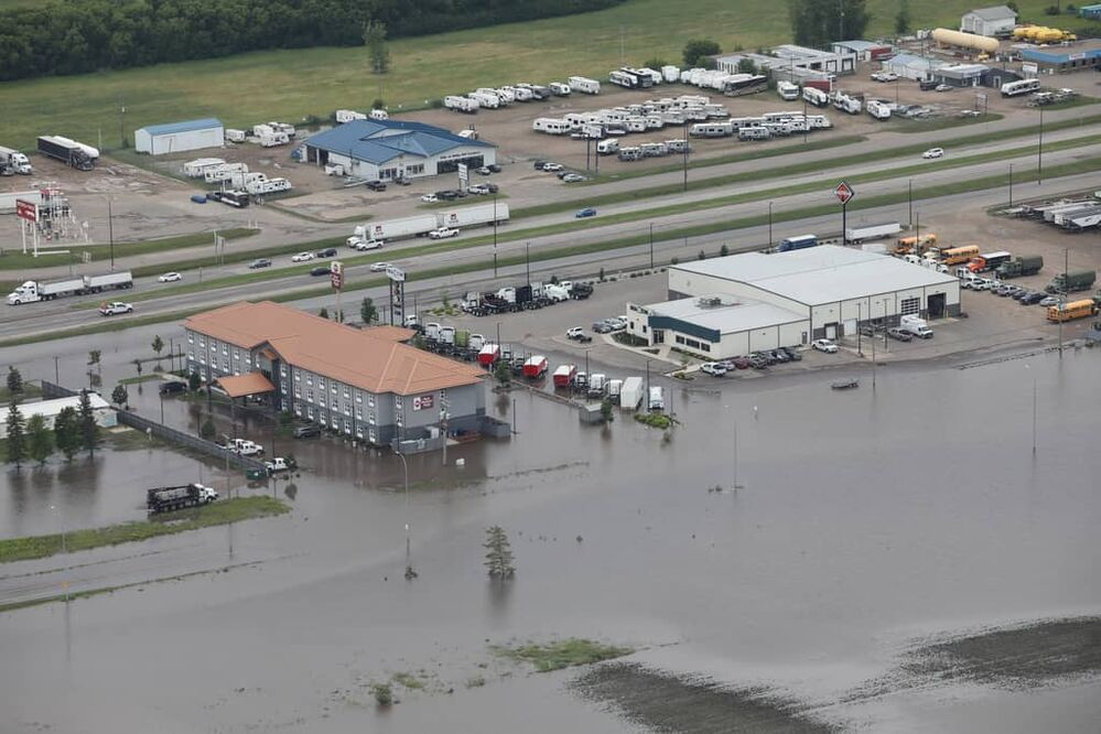 Overland flooding covers Middleton Avenue near Highway 1 and Highway 10 in Brandon on Monday after heavy downpours Sunday evening into overnight. (Tim Smith/The Brandon Sun)