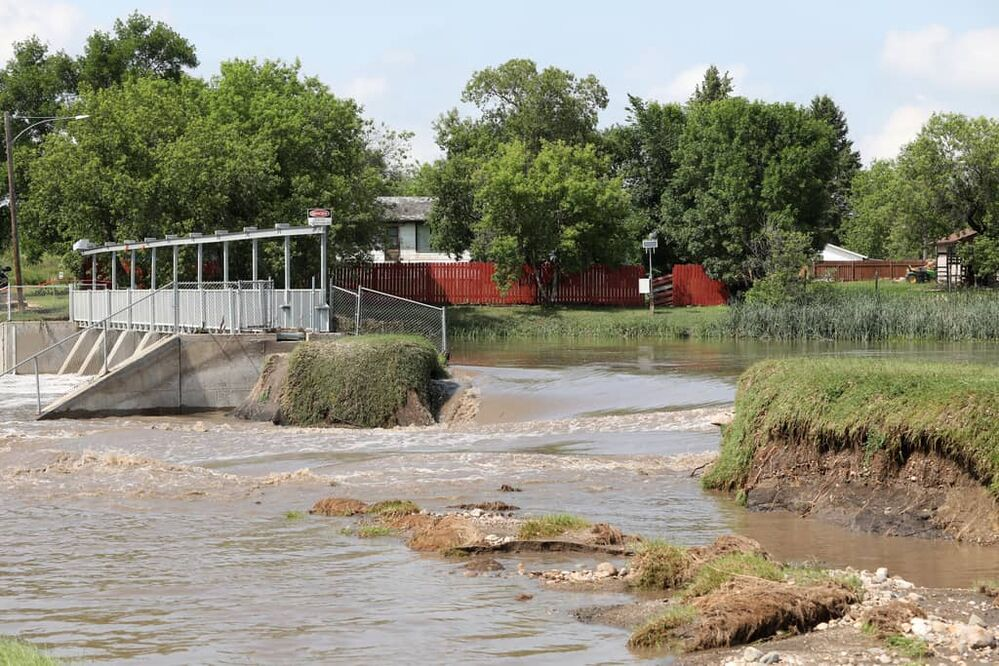 The dam on the Little Saskatchewan River at Rapid City gave out on Monday after heavy downpours Sunday evening into overnight caused widespread flooding. (Tim Smith/The Brandon Sun)