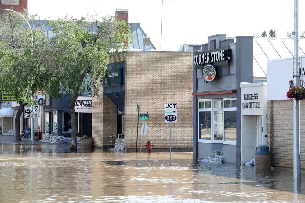 Businesses flooded on Main Street in Minnedosa on Monday after heavy downpours Sunday evening into overnight caused widespread flooding. The swollen Little Saskatchewan River overflowed into downtown Minnedosa flooding several businesses and residences. (Tim Smith/The Brandon Sun)