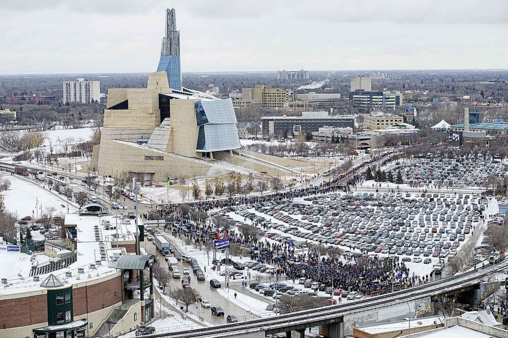 Hundreds of Winnipeggers walk past the Goldeyes Stadium Tuesday afternoon as they cheer on their Winnipeg Blue Bombers Grey Cup Champions after parading through Portage Ave and Main St. (Mike Sudoma / Winnipeg Free Press)  -