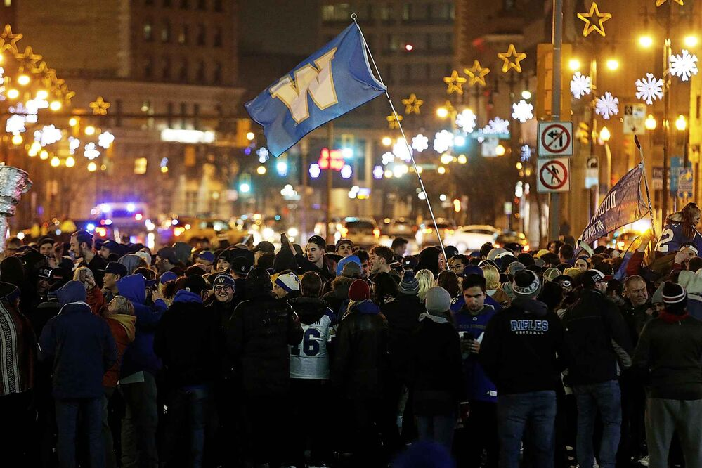 Winnipeg Blue Bomber fans celebrate winning the 107th Grey Cup.  (John Woods / The Canadian Press) -