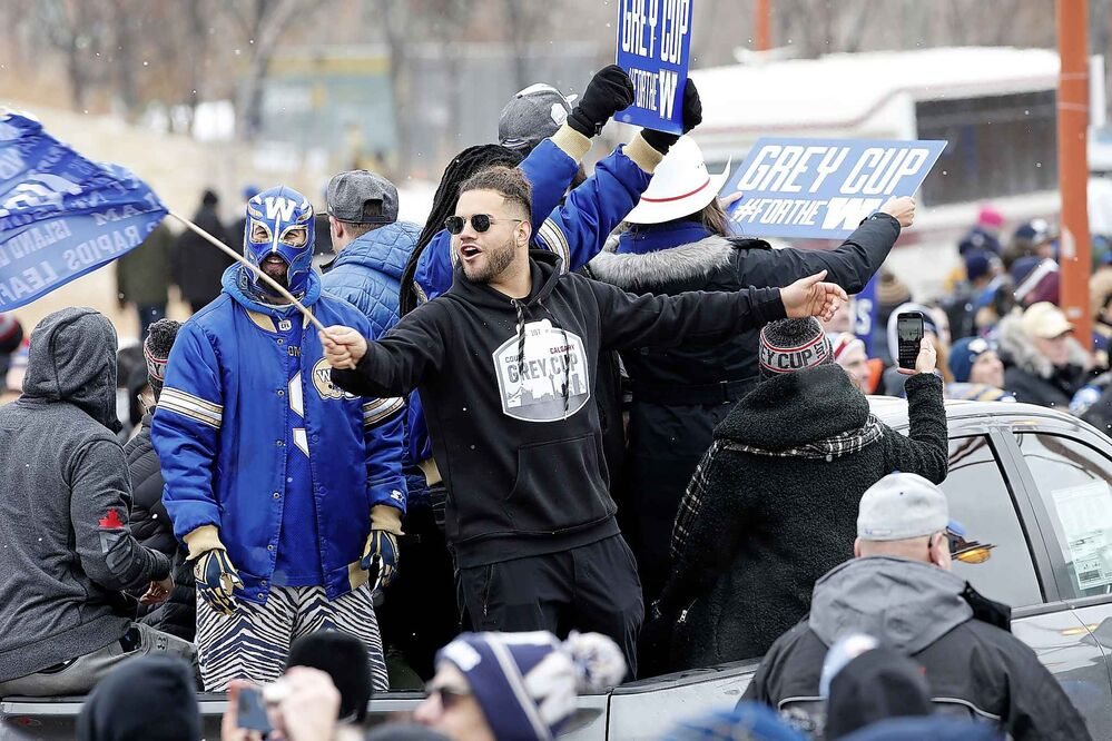 Fans celebrate with Bombers players.  (John Woods / The Canadian Press) - CP