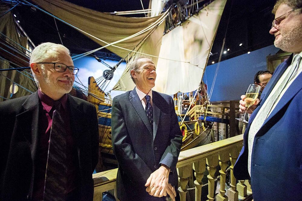 Publisher Bob Cox (centre) laughs with faith reporter John Longhurst (left) and columnist Doug Speirs at the Manitoba Museum Tribute Gala. - MIKAELA MACKENZIE / WINNIPEG FREE PRESS