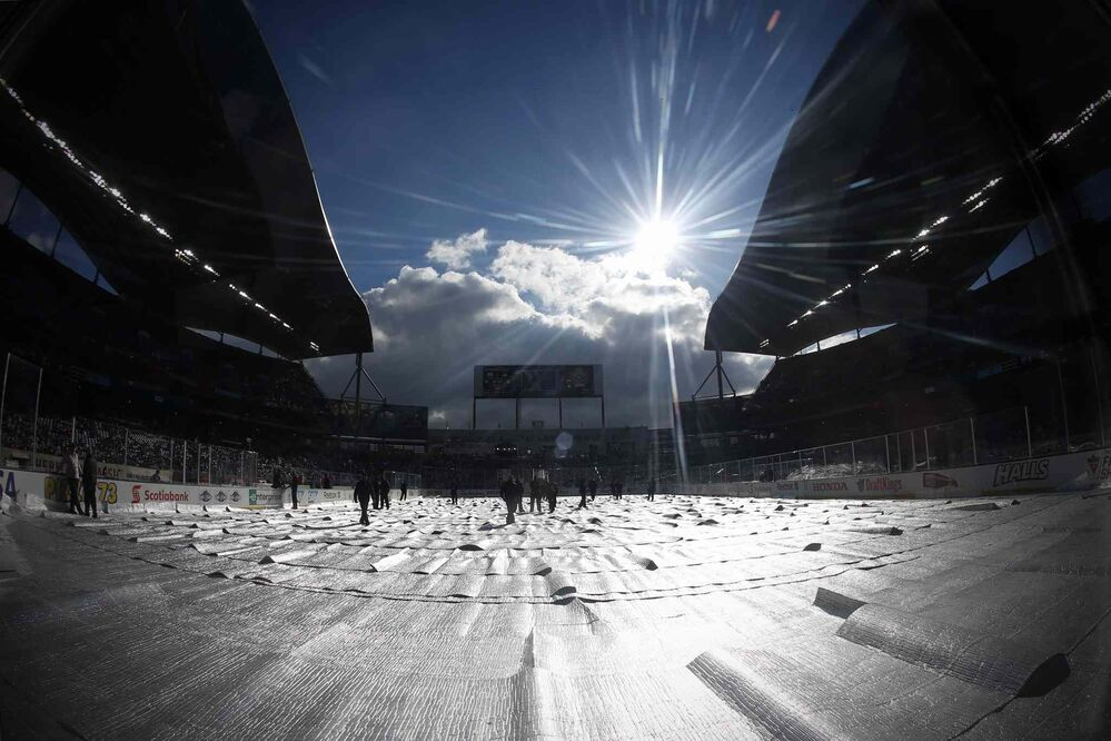 NHL Heritage Classic action has been delayed because it is too nice a day in Winnipeg on Sunday. Organizers had to wait for the sun go behind the grandstand or for some clouds to roll in.  - JOHN WOODS / THE CANADIAN PRESS
