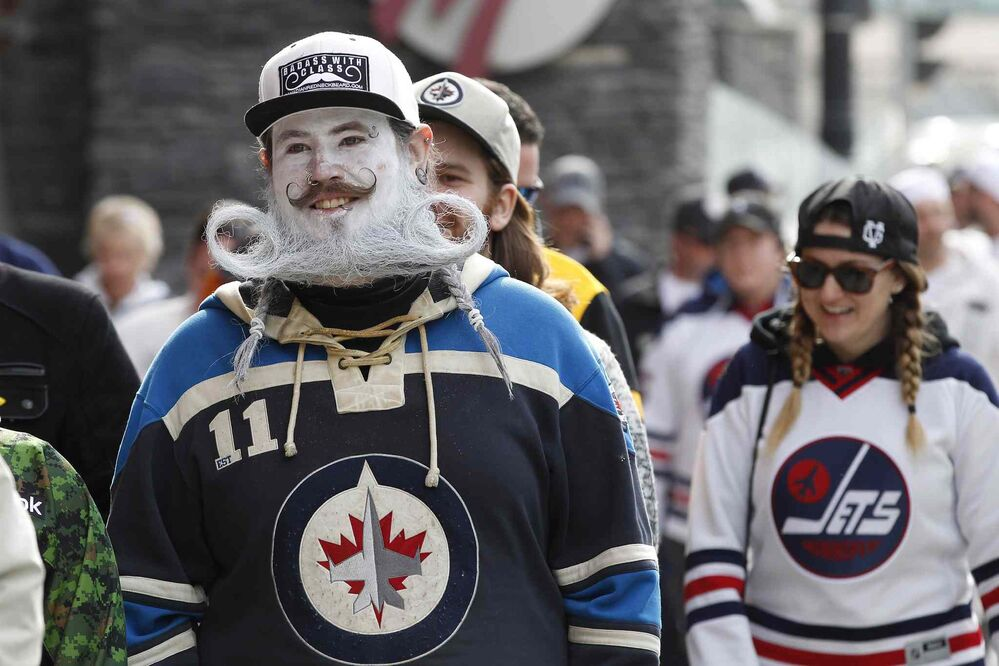 JOHN WOODS / THE CANADIAN PRESS<br>Fans get in the playoff spirit at the Winnipeg Jets White Out Street Party prior to game one of the playoff series against Minnesota Wild Wednesday, April 11, 2018.<br>