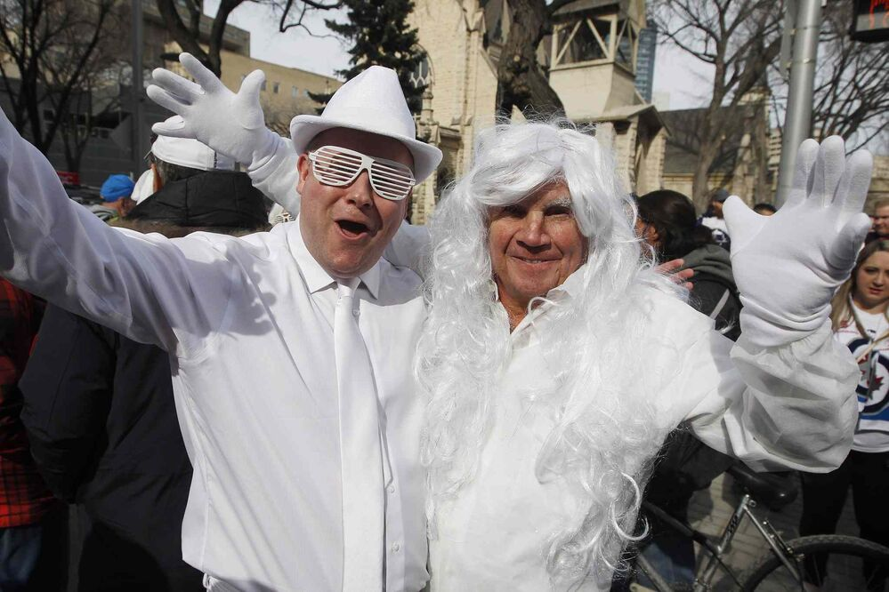 JOHN WOODS / THE CANADIAN PRESS<br>Joshua and Stan Plett get in the playoff spirit at the Winnipeg Jets White Out Street Party prior to game one of the playoff series against Minnesota Wild Wednesday, April 11, 2018.<br>