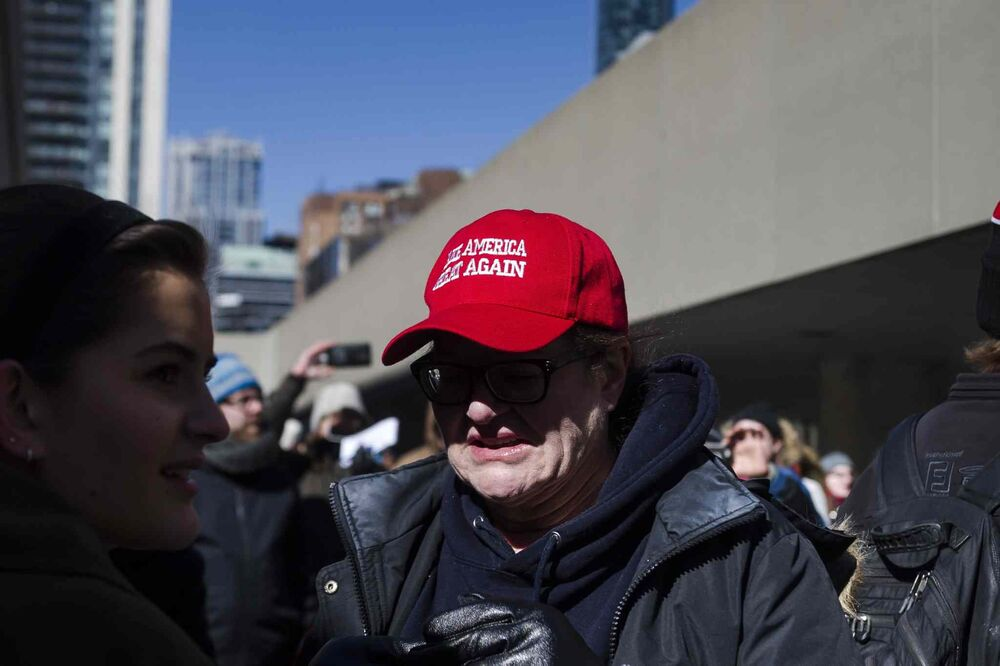 "A woman wears a ""Make America Great Again"" hat during a demonstration regarding motion M-103 inToronto. - CHRISTOPHER KATSAROV / THE CANADIAN PRESS"