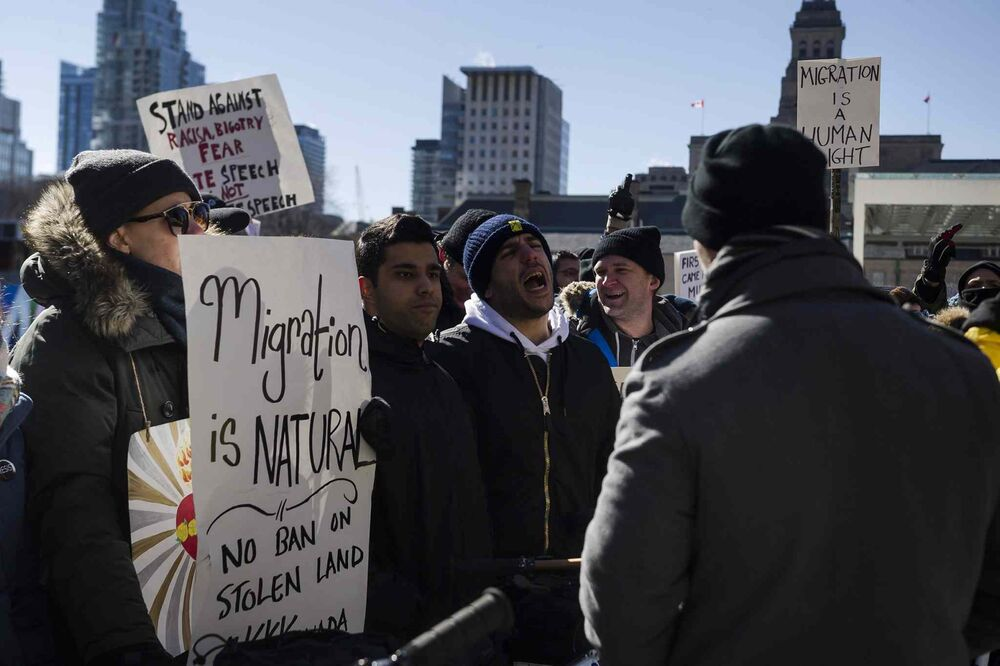 Protesters gather during a demonstration regarding motion M-103 at Toronto City Hall on Saturday. - CHRISTOPHER KATSAROV / THE CANADIAN PRESS