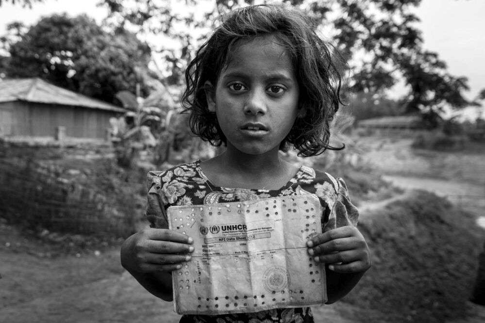 Stateless Children, 2014<br>Muhammad Munimuzzaman Khan, Winnipeg<br>This girl lives in a refugee camp in Bangladesh for Rohingya Muslims who have fled the neighbouring Myanmar where they face religious persecution. The refugees are not allowed to settle in Bangladesh beyond the camp. Nor can they return to Myanmar.<br>
