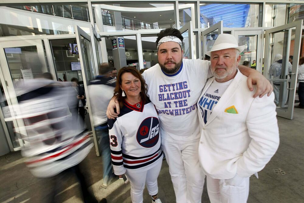 PHIL HOSSACK / WINNIPEG FREE PRESS -Riley Smith (centre) with his dad Dan and Step Mom Alana Brownlee pose at the BELL/MTS centre before game two Friday evening. They