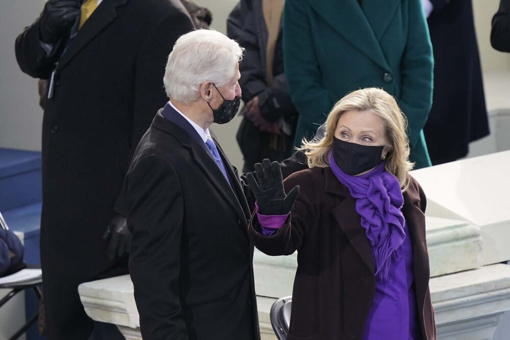 Carolyn Kaster / The Associated Press<br>Former U.S. president Bill Clinton and former secretary of state Hillary Clinton arrive for the 59th Presidential Inauguration at the U.S. Capitol in Washington on Wednesday.<br>