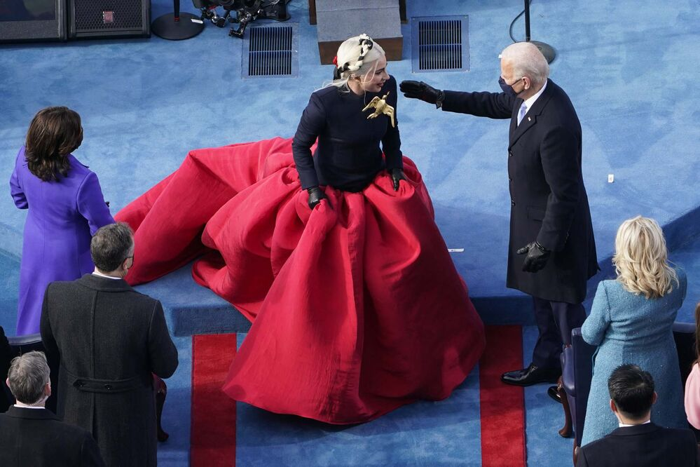 Susan Walsh / Pool / The Associated Press<br>President-elect Joe Biden greets Lady Gaga during the 59th Presidential Inauguration at the U.S. Capitol in Washington on Wednesday.<br>