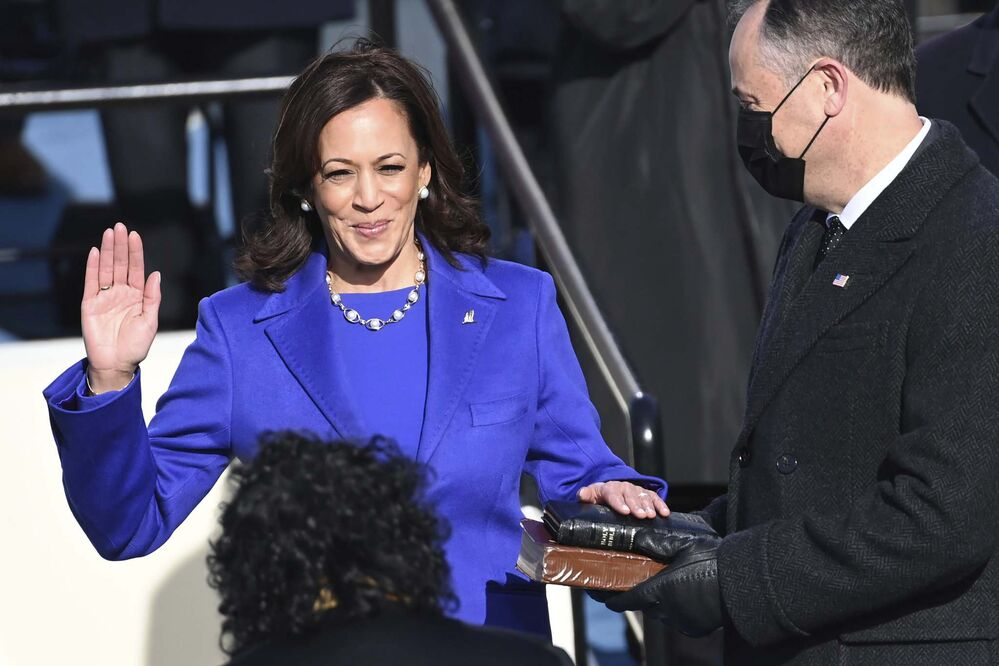 Saul Loeb / Pool / The Associated Press<br>Kamala Harris is sworn in as vice-president by Supreme Court Justice Sonia Sotomayor as her husband Doug Emhoff holds the Bible during the 59th Presidential Inauguration at the U.S. Capitol in Washington on Wednesday.<br>