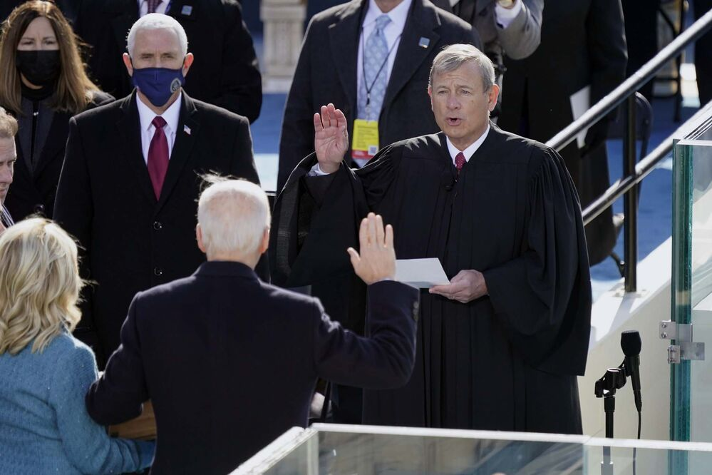 Carolyn Kaster / The Associated Press<br>Joe Biden is sworn in as the 46th president of the United States by Chief Justice John Roberts as Jill Biden holds the Bible during the 59th Presidential Inauguration at the U.S. Capitol in Washington on Wednesday.<br>
