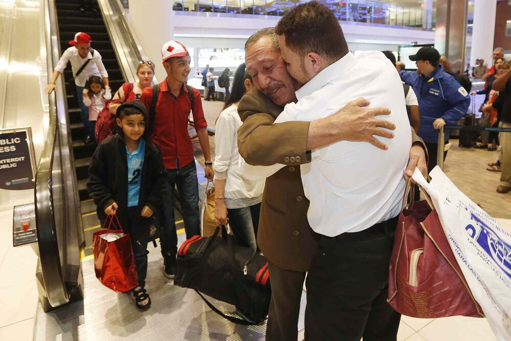 Khudher Naso and his family are greeted by family and supporters at the Winnipeg airport, July 11, 2016. The Yazidis families arrived from Turkey. -