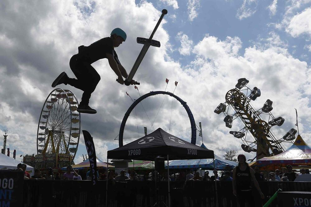Tone Staubs of the XPogo Stunt Team performs at the Red River Ex, June 19, 2016. -