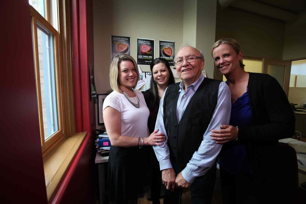Theodore Fontaine with Canadian Centre for Child Protection staff - Christy Dzikowicz (right), Avery Wolaniuk (centre) and Kaleigh Hamilton in Fontaine's former residential school classroom.  (Ruth Bonneville / Winnipeg Free Press)