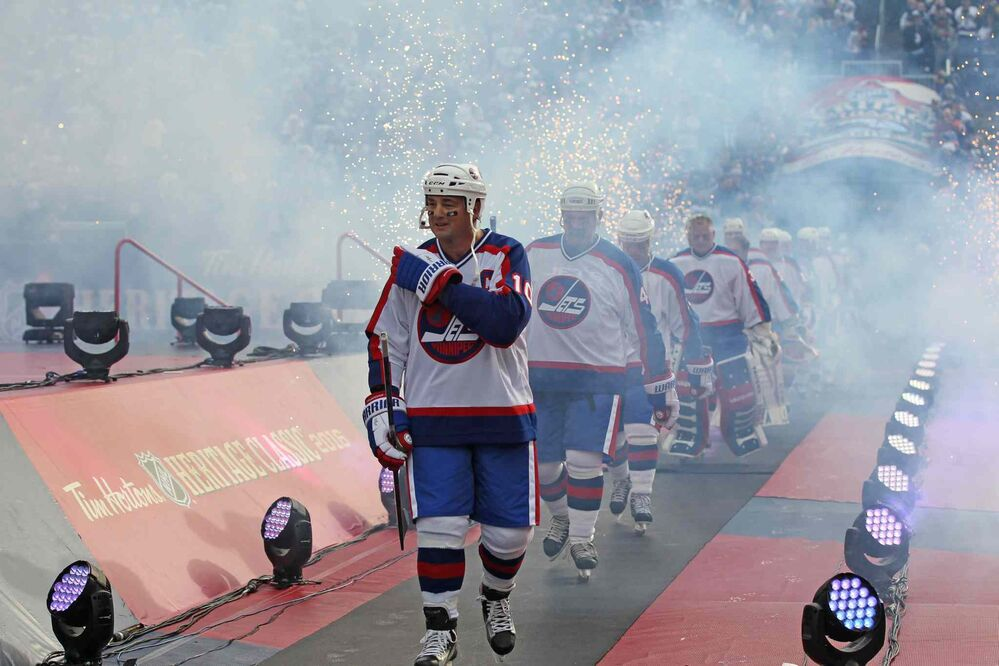 Dale Hawerchuk, as Jets Alumni Team Captain, leads his team out onto the ice to play against the Edmonton Oilers during the  2016 Tim Hortons NHL Heritage Classic Alumni Game at Investors Group Stadium last October. (Ruth Bonneville / Winnipeg Free Press files) - RUTH BONNEVILLE / WINNIPEG FREE PRESS