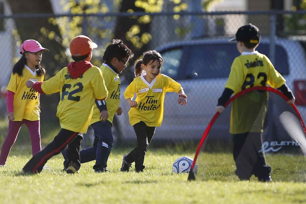 Girls take part in a soccer program that encourages participation by inner-city girls Tuesday, May 19, 2015. John Woods / Winnipeg Free Press - Winnipeg Free Press