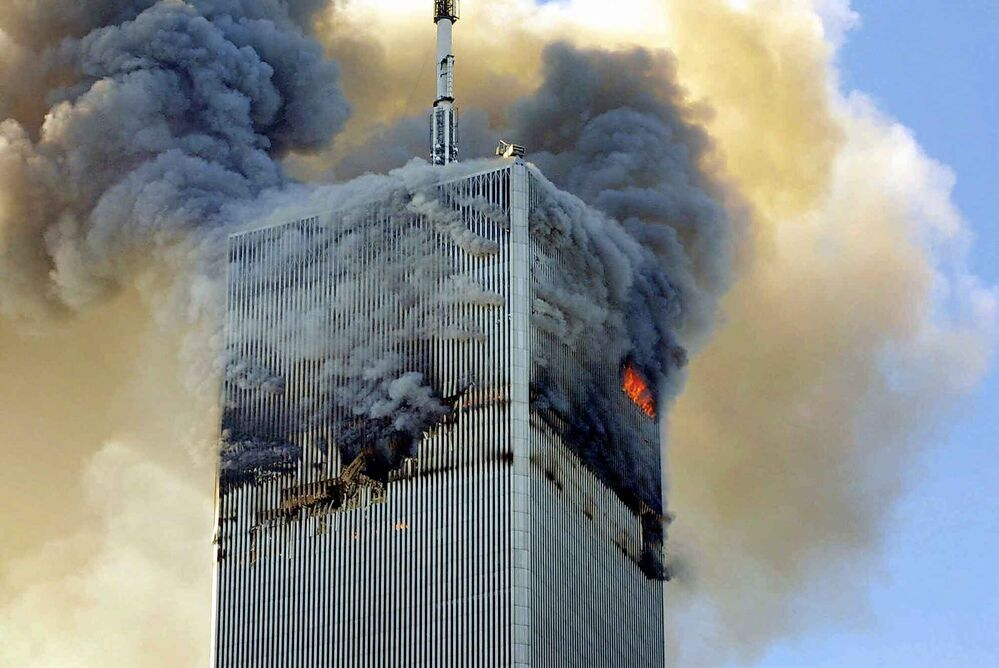 Fire and smoke billows from the north tower of New York's World Trade Center on Tuesday, Sept. 11, 2001. (AP Photo/David Karp)