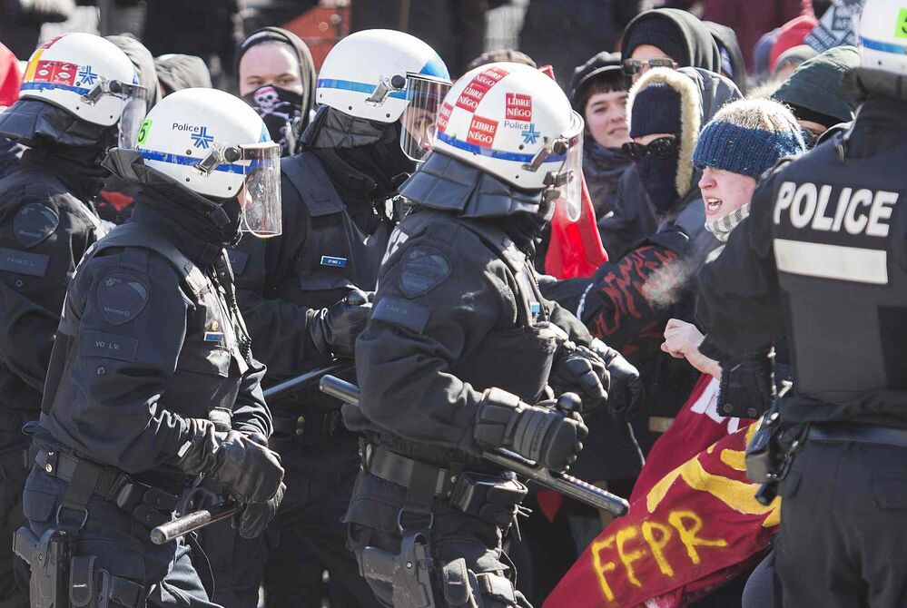 Police hold back protesters in Montreal. - GRAHAM HUGHES / THE CANADIAN PRESS