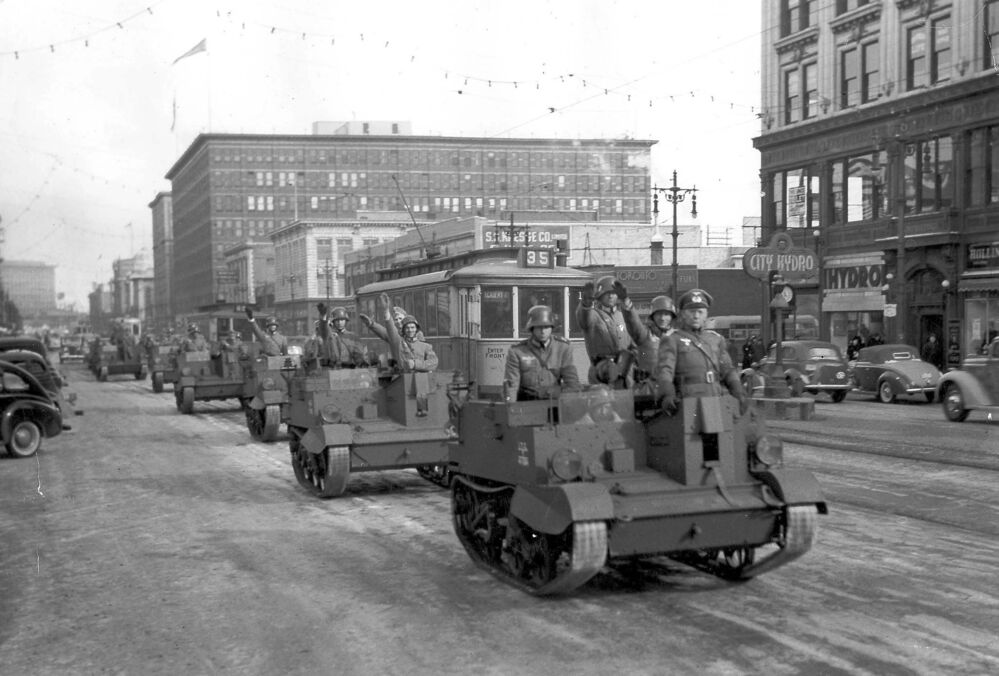 Nazi troops, played by the young men's division of the Board of Trade, parade down Portage Avenue, renamed Adolf Hitler Strasse during mock invasion. - Winnipeg Free Press Archives