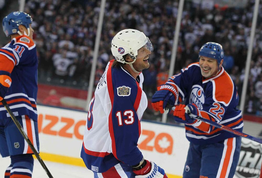 Winnipeg Jets Alumni player Teemu Selanne smiles as he celebrates at the end of the game after the Jets won 6-5 against the Edmonton Oilers during the  2016 Heritage Classic Alumni Game at Investors Group Field. Oct. 22, 2016  -