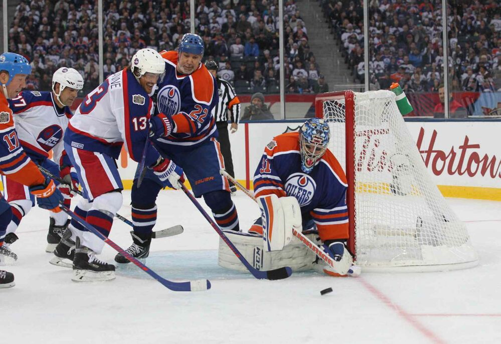 RUTH BONNEVILLE / WINNIPEG FREE PRESS Teemu Selanne tries to get the puck past Edmonton Oilers goalie during third period action.  October 22, 2016 -