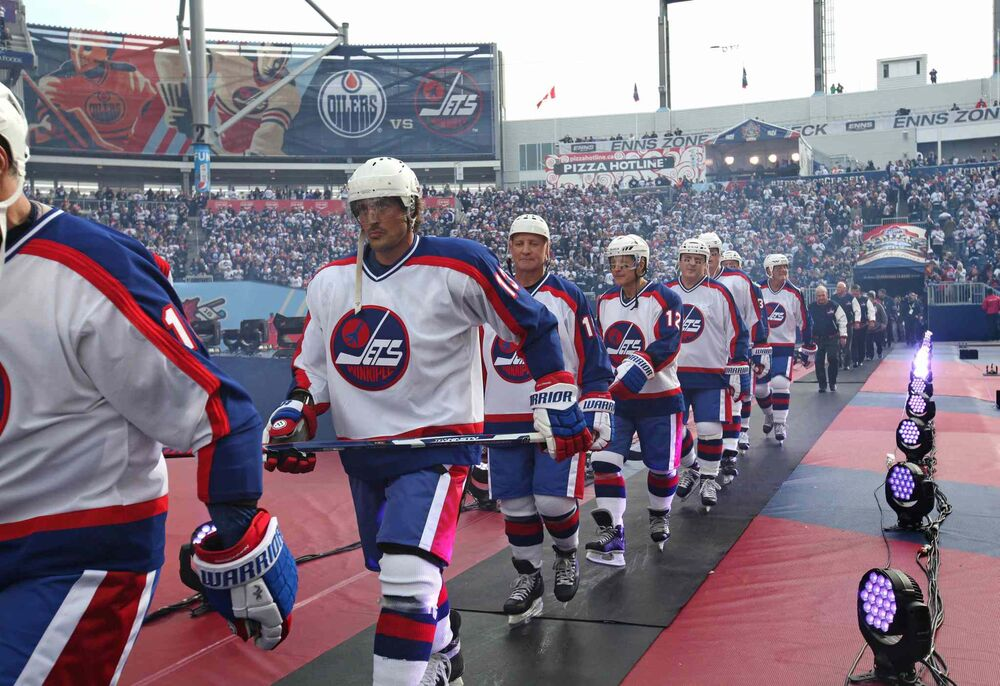 Winnipeg Jets Alumnus Teemu Selanne heads onto the ice along with the rest of the team as they prepare to play against the Edmonton Oilers during the 2016 Heritage Classic Alumni Game at Investors Group Field. Oct. 22, 2016  -