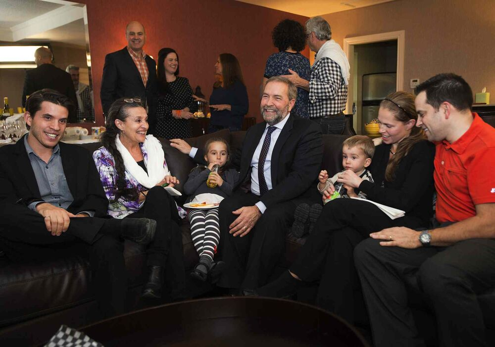 NDP leader Tom Mulcair watches the results come in with his son, Greg, left, wife Catherine, granddaughter Juliette, and grandson Raphael,  daughter-in-law, Jasmine, and son Matthew Monday, October 19, 2015 in Montreal.  THE CANADIAN PRESS/Ryan Remiorz - CP