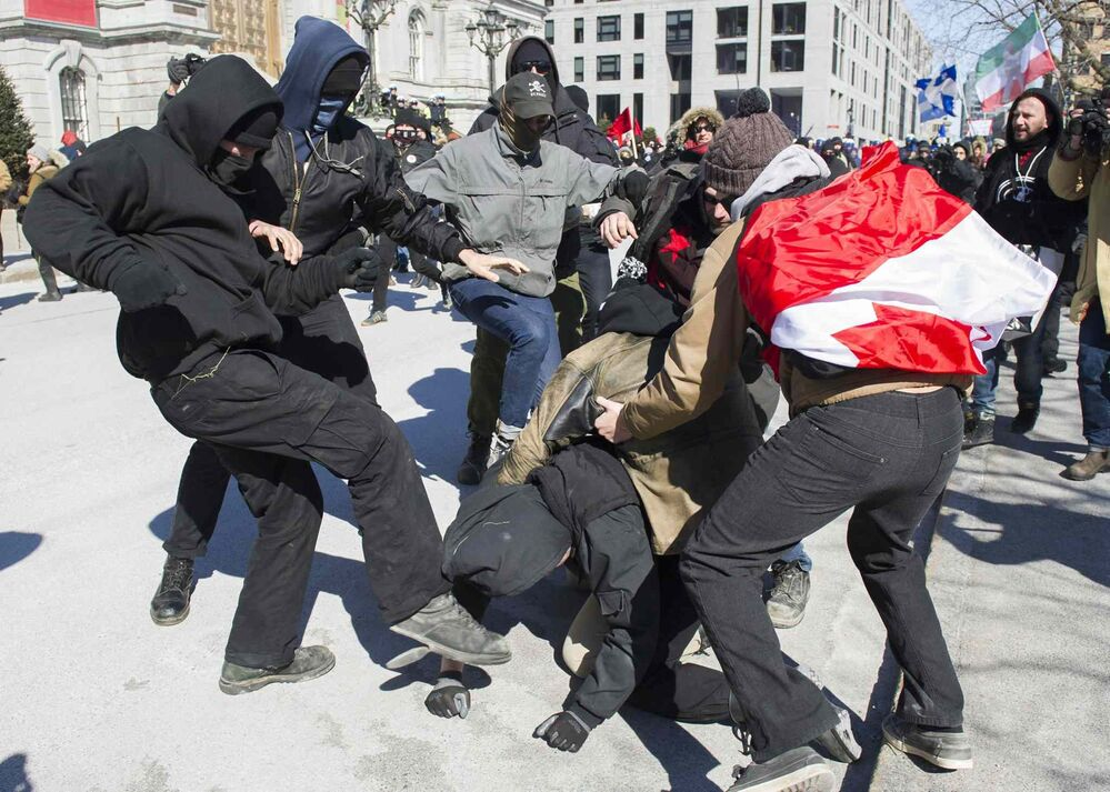 Opposing groups of protesters clash Montreal. - GRAHAM HUGHES / THE CANADIAN PRESS