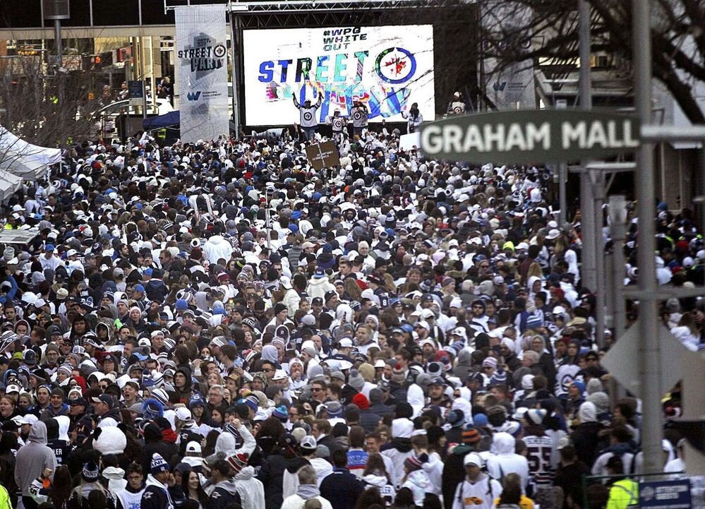 PHIL HOSSACK / WINNIPEG FREE PRESS -Jets fans pack Donald Street Friday night as the Winnipeg Jets and Minnesota Wild face off. Stand-Up - April 13, 2018<br>