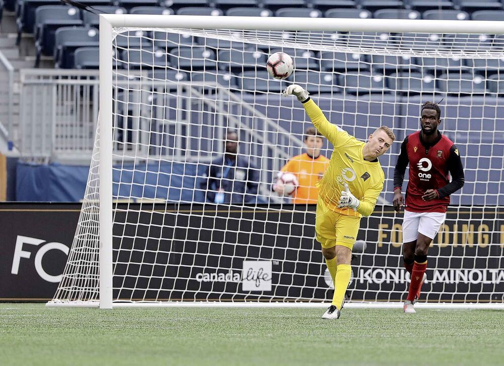 Valour FC goalkeeper Tyson Farago plays the ball against FC Edmonton.<br>