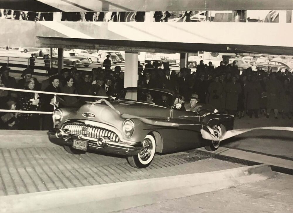 HBC ARCHIVES<br>The Bay store manager and first customers drive through a ribbon on Oct. 19, 1954, the day the Bay Parkade opened.<br>