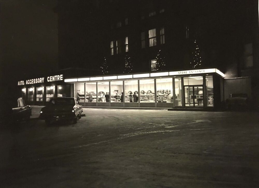 HBC ARCHIVES<br>The Auto Centre lit up just after the new year in 1965<br>