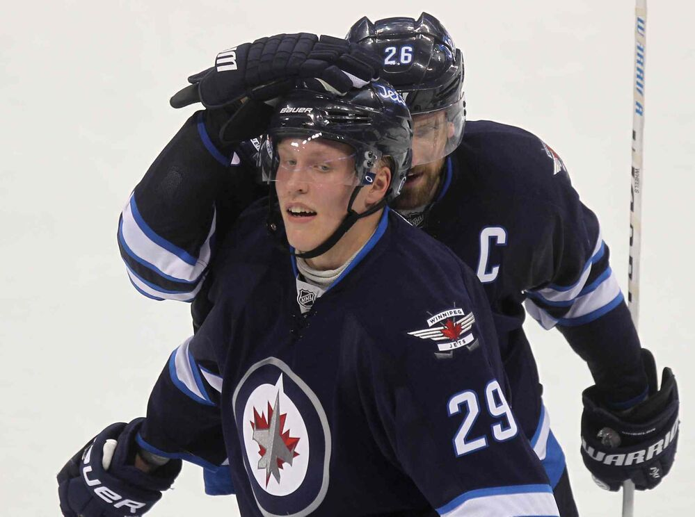 Winnipeg Jets captain Blake Wheeler gives #29 Patrik Laine (29) a head shake in celebration for the way he played and their winning score against the Carolina Hurricanes at the MTS Centre. - RUTH BONNEVILLE / WINNIPEG FREE PRESS