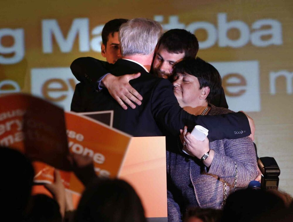 NDP Leader Greg Selinger with his wife Claudette and sons Eric and Pascal, left, on stage at the RBC Convention Centre after losing the provincial election to Brian Pallister's PC party. April 19, 2016. -