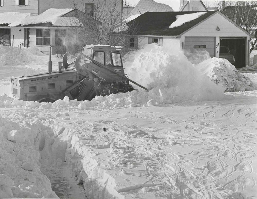 A plow clears out Hind Avenue in St. James. (Jack Ablett / Winnipeg Free Press Archives)