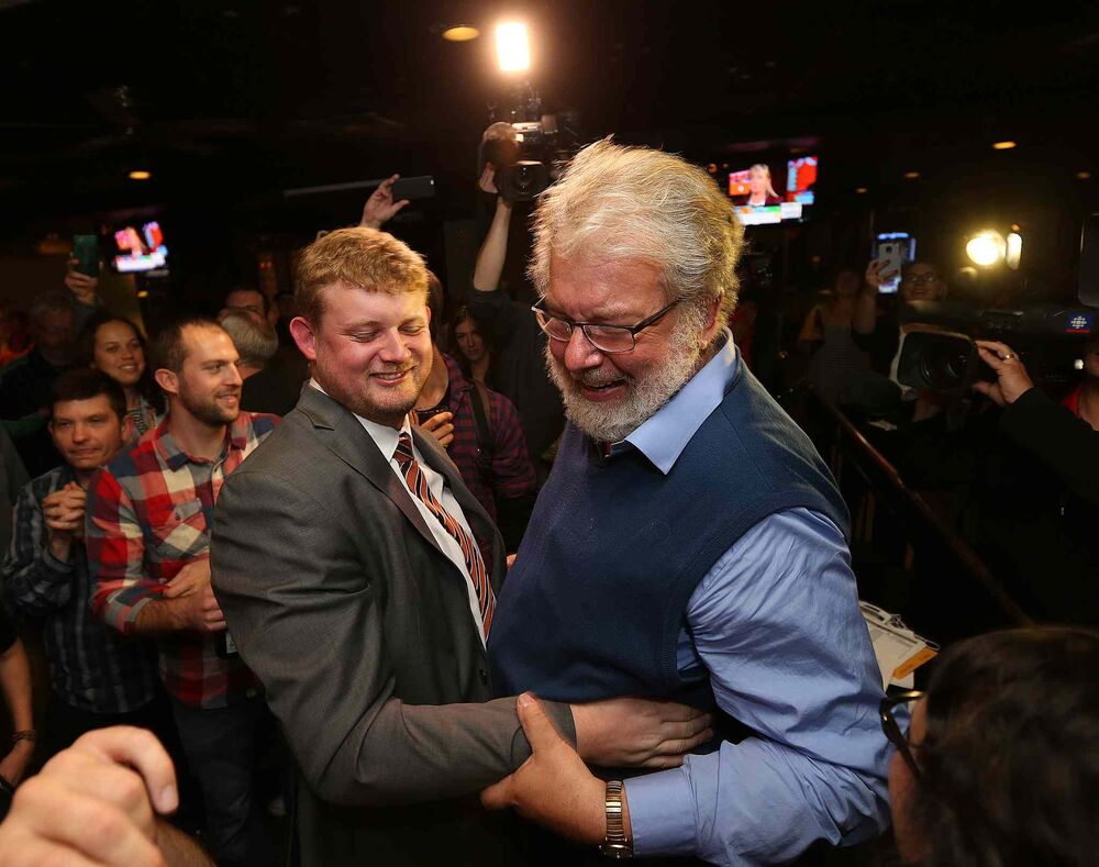 NDP candidate for Elmwood-Transcona, Daniel Blaikie, celebrates victory with his father Bill Blaikie at the New Cavalier Inn on Regent Avenue West. on Mon., Oct. 19, 2015.  - Jason Halstead / Winnipeg Free Press