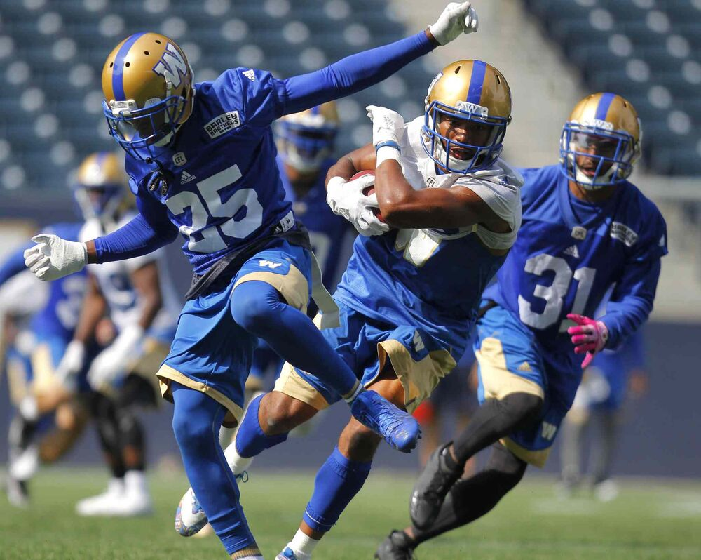 Winnipeg Blue Bombers Bruce Johnson, Gerrard Sheppard and Maurice Leggett during a practice on  September 2, 2016 -