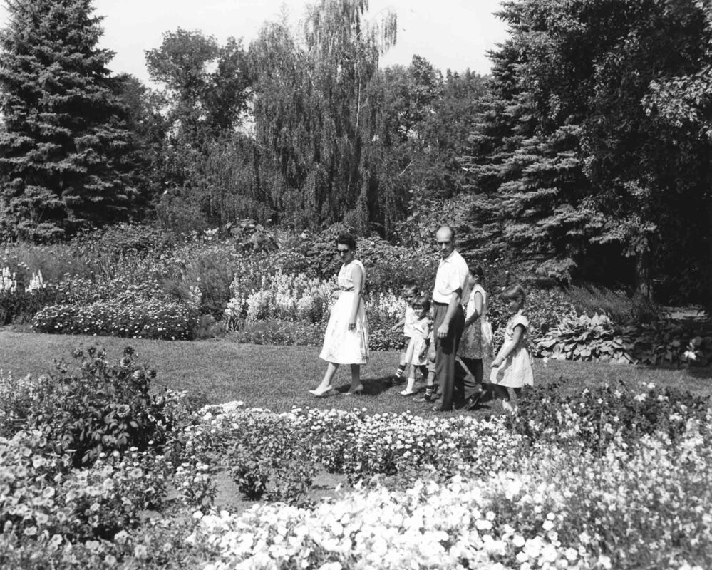 A family wantders through Assiniboine Park gardens in 1966. - PROVINCE OF MANITOBA