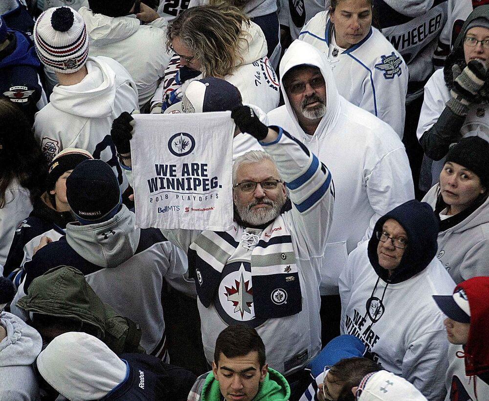 PHIL HOSSACK / WINNIPEG FREE PRESS -Showing their true colors. Jets fans pack Donald Street Friday night as the Winnipeg Jets and Minnesota Wild face off. Stand-Up - April 13, 2018