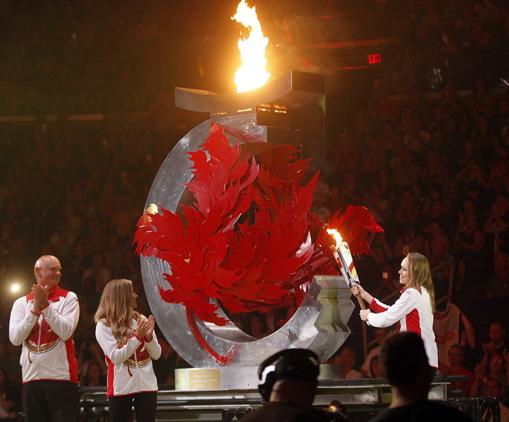 Cindy Klassen lights the cauldron, - PHIL HOSSACK / WINNIPEG FREE PRESS