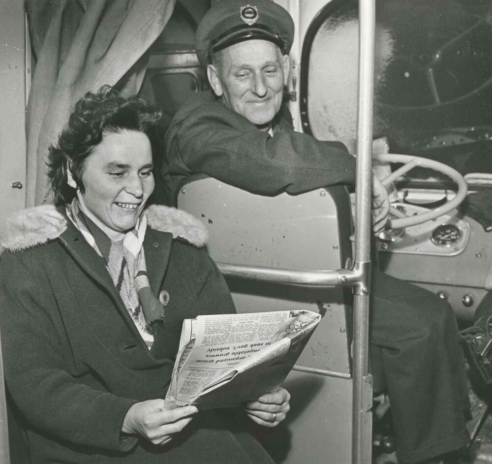 A driver and passenger who spent all day and night aboard a transit bus. (Jack Ablett / Winnipeg Free Press Archives)