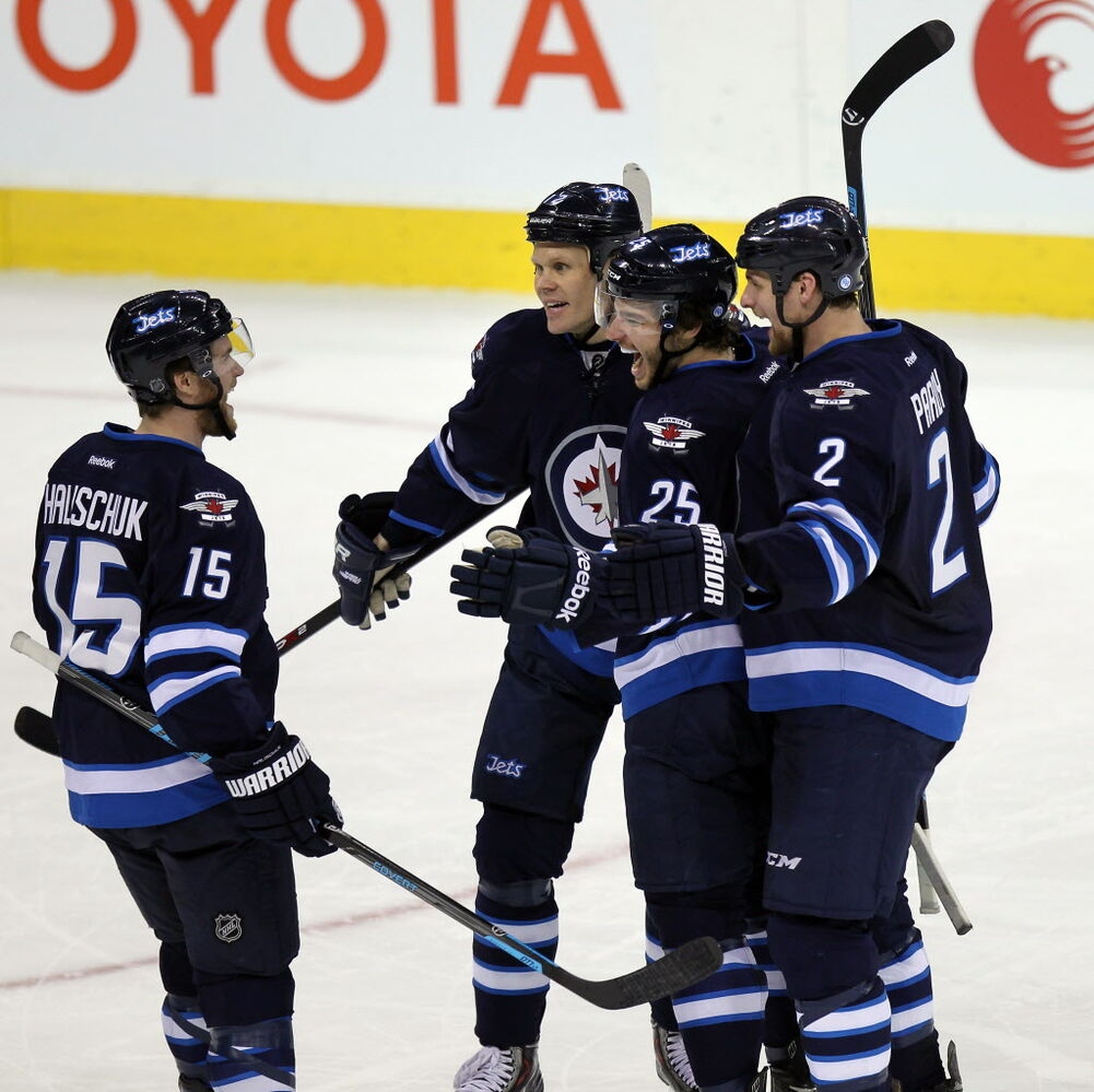 Left to right Winnipeg Jets Matt Halischuk, Ollie Jokinen, Zach Redmond and Adam Pardy celebrate Redmond's go-ahead goal  Thursday during second period action. Pardy assisted on the point.  (Phil Hossack / Winnipeg Free Press)