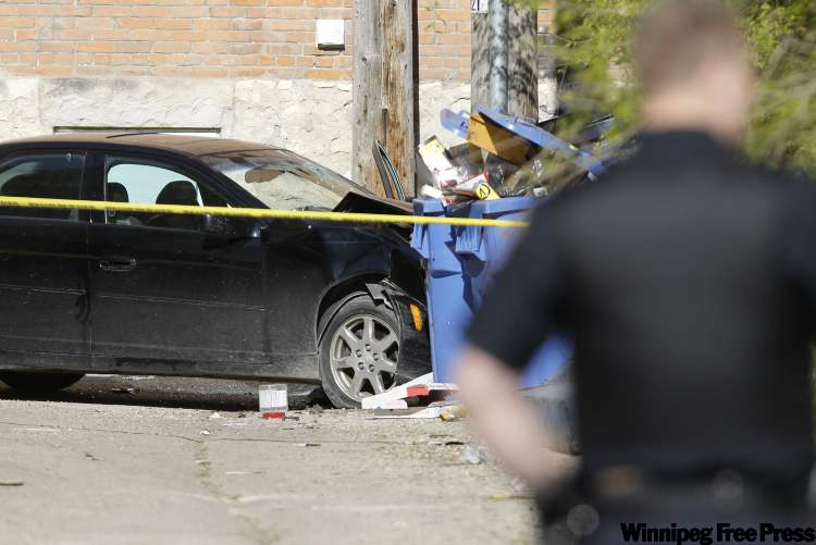 Police investigate in West Broadway today following shooting.
