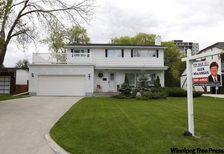 Home for sale on Agassiz Drive in the summer.