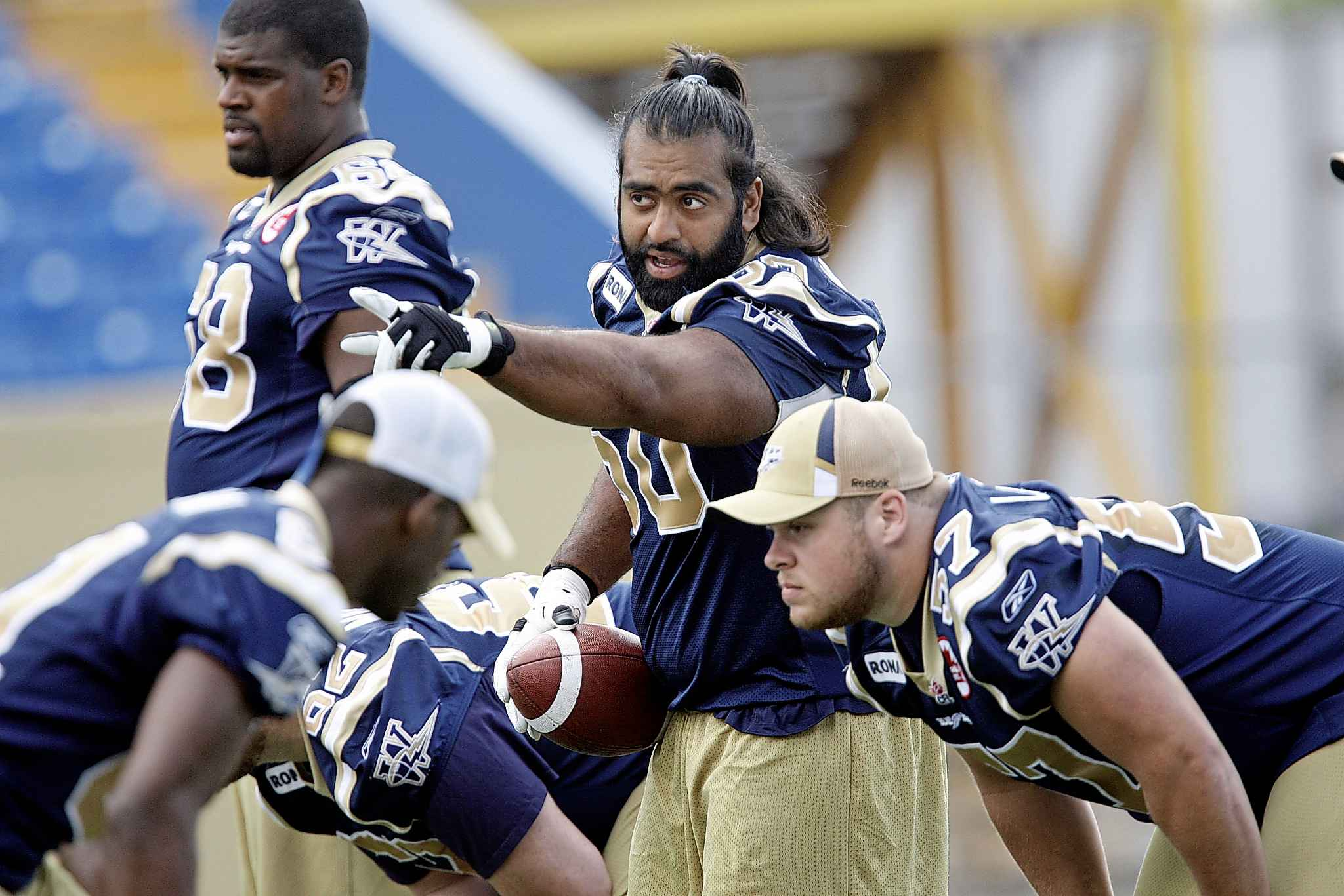KEN GIGLIOTTI / WINNIPEG FREE PRESS FILES</p><p> Khan, seen here in 2010, resumed his career in 2008 with the Bombers after a battle with Crohn's disease. He announced his retirement in early 2012.</p>