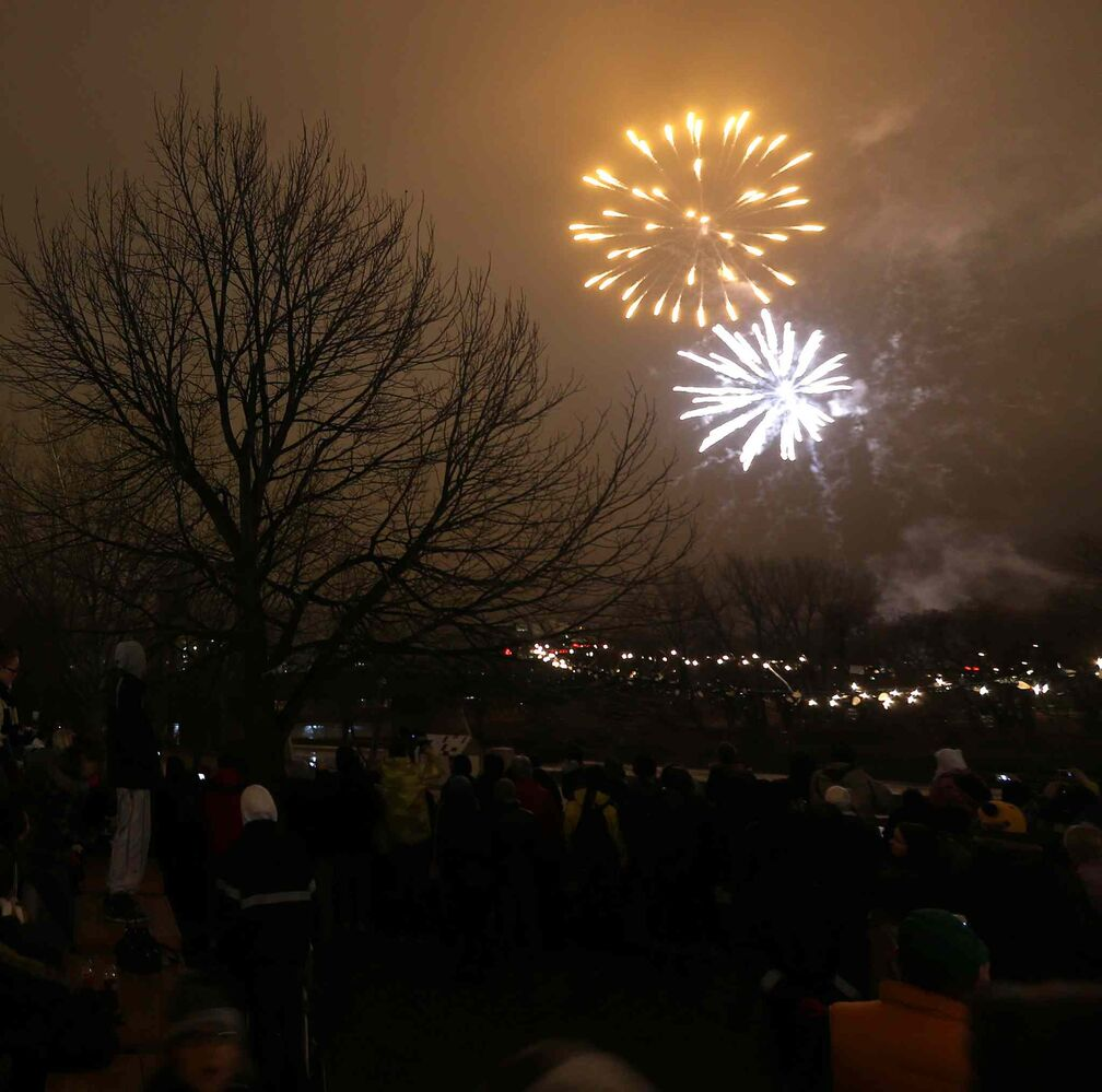 Fireworks light up the night sky at The Forks following the Santa Claus Parade. (TREVOR HAGAN / WINNIPEG FREE PRESS)