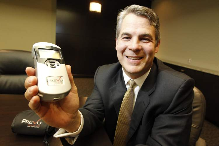 Christopher Moreau, President & Chief Executive Officer of Miraculins. Moreau is holding a spectrophotometer, which measures cholesterol levels in a persons skin'.
